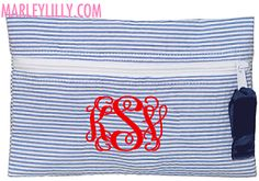 http://www.marleylilly.com/Monogrammed-Seersucker-Cosmetic-Bag-in-Navy_p_1886.html  Seersucker Cosmetic Bag: Navy Thread Color: Hot Pink Font: Master Circle Script Monogram: Jenna Marie Visage Last Initial: V Full Last Name: Visage Style: Female Style(LAST INITIAL will be in middle) Can We Change Your Font?: Yes, if something else looks better