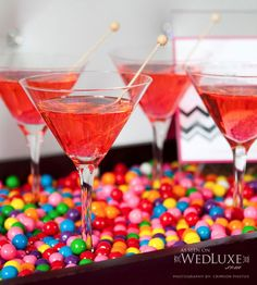 Bubblegum martinis served on a platter of gum balls ~ Recipe for Bubblegum Martinis: 2 oz. bubblegum flavoured vodka, 1 oz. ginger ale, 1 oz. cranberry juice.   Shake with ice, strain into a chilled martini glass. Garnish