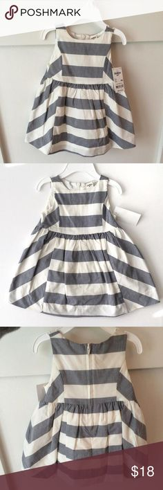 NWT OshKosh Girls Summer Dress 9 month NWT OshKosh Girls summer dress. Size 9 month. 100% cotton light weight dress. Grey and off white striped and includes off white bloomers. Off white stripes are similar to a white linen color, it is not a bright white. So cute, wish my little one got to wear it but was too big during the summer months. Sold without hanger. Osh Kosh B'Gosh Dresses