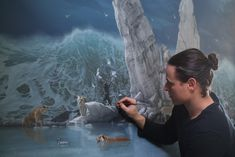Joel Rea with his painting The Promised Land