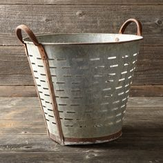 Found Olive Bucket. I think I want these everywhere. They'd be perfect for a large group of orchids with all that air circulation. Or as a hamper, cleaning tote, guest towel bin, hanging planter, you name it! I love these.