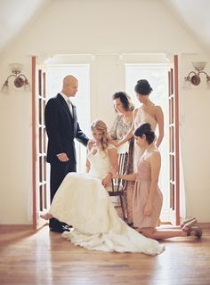family praying before the wedding. Grooms family too. Then bride & groom without seeing each other