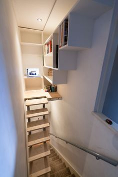 I designed some raising stairs, a platform and a bookcase to make use of the dead space above the existing stairs in my flat. The stairs raise up when the 'Library' isn't in use with the help of a pump like you get in an office chair. Over Stairs Storage, Stairway Storage, Under Stairs, Stairs For Tight Spaces, Dead Space, Basement Stairs, Basement Ideas, Basement Renovations, Stairways