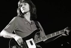 Geddy Lee of Rush performs on stage at Ahoy on November 1981 in Rotterdam Netherlands He plays a Rickenbacker 4001 bass guitar Rickenbacker 4001, Geddy Lee, Neil Peart, Metal Drum, Big Time Rush, Great Bands, Music Artists, Rock Bands, Stage
