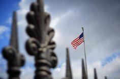 America. The Birthplace of Jazz. #american #flag #americanflag #ironfence #iron #fence #stlouiscathedral #jacksonsquare #frenchmarket #frenchquarter #frenchdistrict #nola #neworleans #louisiana #followyournola #spring #may #2016 #nikon #nikond3200 #travel #itsyournola #travel by leeboggspics