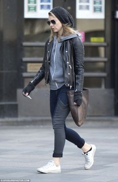 Trend-setter: Completing the trendy look, she layered up with a grey hoodie and a black le...
