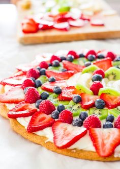 This fruit pizza with cream cheese frosting is so easy to make, gorgeous and super yummy. Fresh berries, kiwi, peaches on a giant frosted cookie. YUM!