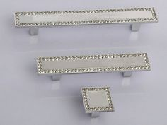 Glass Crystal Look Dresser Pulls Drawer Pull Handles Cabinet Door Handle Rhinestone Clear Gold Silver Modern Kitchen Cupboard Bling Hardware  The price is for one piece of the knob or handles. 3 style to choose from.  Material: zinc alloy + glass crystal Color: silver (chrome) + clear Measurement:  Knob- 1x1 (25 x 25 mm) Height: 0.8 (20 mm)  Smaller handles- Length: 4.25 (108 mm) Width: 0.7 (17 mm) Holes Space: 2.5 (64 mm) When installed the knob sticks out 0.8 (20 mm)  Larger handles…