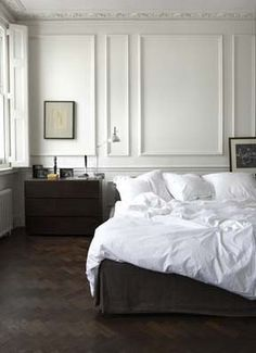 Bright bedroom with beautiful moulding.