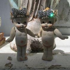 Bisque kewpie doll wall decor