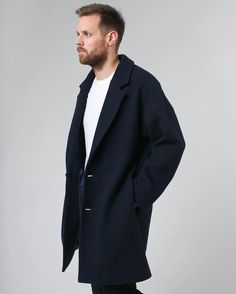 Olav Coat | A timeless virgin wool coat, with dropped shoulders. Its subtly updated shape with an oversized fit gives it that modern luxurious look.  See more of this at www.arvdesign.no