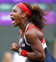 Serena Williams yells after breaking the serve and defeating Caroline Wozniacki of Denmark at the Olympic All England Lawn Tennis Club.
