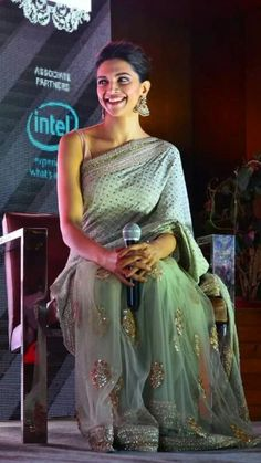 Cute Smiling Deepika Padukone in Saree