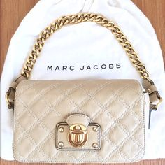"""MARC JACOBS Ingrid Quilted Leather Bag Purse Almond quilted leather shoulder bag with gold hardware and chain link strap. Stitch detailing, concealed button closure and canvas lining. There are a few very small pen marks under the flap as pictured (none on outside of the bag) and some scratches from normal wear. 9""""W x 4.5""""H x 3""""D. Overall good condition and comes with the original dust bag. Purchased from Net-A-Porter. Marc Jacobs Bags Shoulder Bags"""
