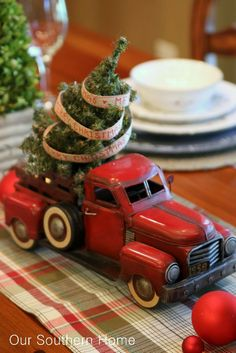 What a cool and unique Christmas centerpiece for the table - an old truck with a tree in the back.
