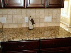 Kitchen Counter Backsplash backsplash with gold granite countertop | here are santa cecilia