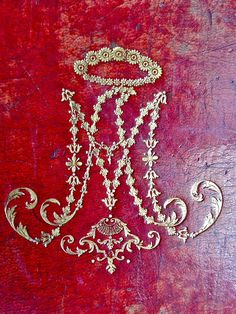 This cypher of Marie Antoinette adorns the cover of her Prayer Book.