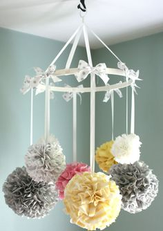 Pretty mobile...would do this with pink, cream and gold.    http://www.etsy.com/listing/164882291/nursery-mobile-baby-mobile-crib-mobile