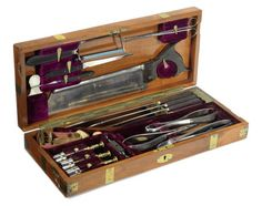 A fine set of field surgeon's amputation instruments, English, mid 19th century, the fitted brass bound mahogany case containing; four steel 'W.Mather' amputation Lister knives, bone saw, set of Aitken pliers, tourniquet, and trepanning instruments, 18ins (45.5cms) wide