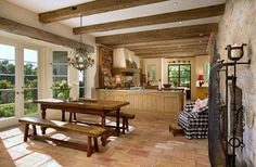 Project 13 - mediterranean - kitchen - santa barbara - Giffin & Crane General Contractors, Inc. Terracotta tile floor against the wood cabinets, wood ceiling planks and brick wall create a character filled, cozy, mediterranean space