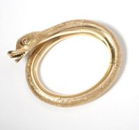 Lot# 147 A gold coiled serpent bangle