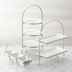 Made of sturdy iron with a nickel-plated finish, this three-tier stand provides a space-saving solution to stacking dinner plates or displaying buffet items. Plates not included. Cool Kitchen Gadgets, Kitchen Items, Cool Kitchens, Kitchen Decor, Kitchen Design, 3 Tier Stand, Tiered Stand, Kitchen Collection, Crate And Barrel