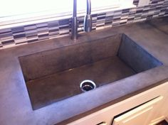 Poured Concrete Countertop with built in deep farm sink. Love this- no caulk/grout line to collect bacteria.