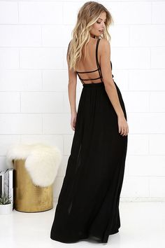 We've got an adventure dreamed up, and it starts and ends with the Lost in Paradise Black Maxi Dress! A surplice bodice with a plunging V neckline meets a strappy, open back and an elastic waistband. Lightweight woven maxi skirt has sexy slits along each side.