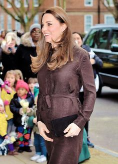 Kate in a brown silk jacquard dress by Hobbs