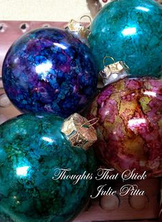 She was so excited to come over to teach me a craft she said! I had such a great time, they were so easy and fun and well look at them! AMAZING! Here is how they are made, you purchase those plain glass ornaments, then some alcohol based re-inkers. We used this little stamper that had felt on the end of it.