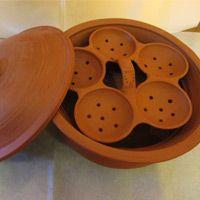 Clay idli (rice cakes) steamer