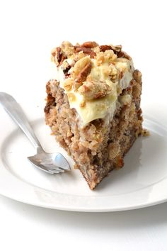 The most delicious Hummingbird Cake I've ever had. It's soft and moist filled with bananas, pecans and pineapple and covered with cream cheese frosting and pecan cookie crumbs. Recipe on sweetestmenu.com #cake #hummingbird #creamcheese #frosting #pecans #baking