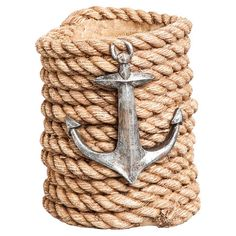Stow your favorite vintage in nautical-chic style with this charming bottle holder, crafted from rope and showcasing an anchor accent.