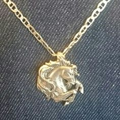 """Sterling Silver Horse Head Necklace Gorgeous rearing Friesian horse in sterling silver. Absolutely beautiful and over 1""""'in size. Stamped .925 and signed on the back and ornate chain is made in Italy, stamped .925 measures 18"""". Beautiful necklace that any horse lover would cherish. Jewelry Necklaces"""