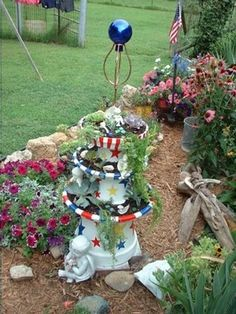 Look what you can do with terracotta pots. Love the red, white and blue theme!!