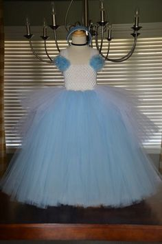Cinderella Inspired Tutu Dress Halloween Costume. $75.00, via Etsy. Notice the white tulle that is shorter on the sides.
