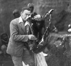 Leonard Woolley holding the noted excavated Sumerian Queen's Lyre, 1922