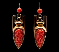 Victorian earrings of gold and carved coral, urn motif.
