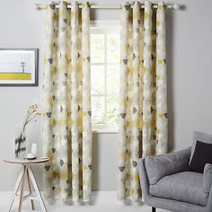 People of Pinterest (with a better eye for interior design than me) - I need help!   What colours do you think I could contrast nicely with these curtains & grey walls for bedside lamps and bedding/cushions?