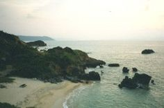 Okuma, Japan. Yes, it's that gorgeous. My dad took me snorkling right near those rocks.
