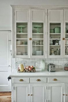 vintage white cabinets are so pretty in the kitchen