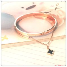 Rose gold hanging black clover charm Bangle High quality rose gold bangle with clasp closure. Brand new in packaging. Jewelry Bracelets