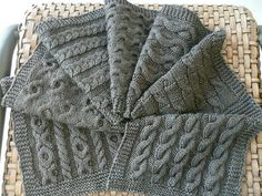 Cable Scarf = different cable squares.  Knitting this one right now .. pretty fun!