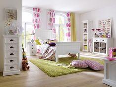 Cosy Bedroom in Berlin exhibiting White Mahogany Furniture www.novasolo.com