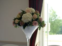 Martini Vase arrangement white hydranges, Faith, Sweet Avalanche and Amnesia roses by Bows & Blooms