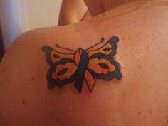 my first tattoo is a down syndrome ribbon made into a butterfly for my oldest daughter that has down syndrome