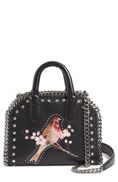 Free shipping and returns on Stella McCartney Mini Falabella Embroidered Faux Leather Tote at Nordstrom.com. Pre-order this style today! Add to Shopping Bag to view approximate ship date. You'll be charged only when your item ships.Delicate coloring enhances the beautiful bird-and-flower embroidery at the front of a studded faux-leather tote edged with signature diamond-cut chain.