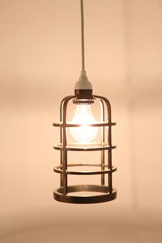 Industrial Metal Cage Pendant Shade $39 - Would love to string up a row of these!