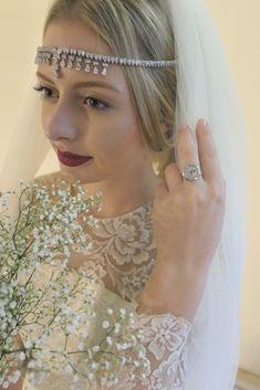Bride wearing a silver watch ring from de Caron.