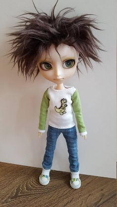 Cute white long sleeved top for Isul doll, with green sleeves, featuring cute dinosaur on the front.